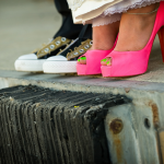 Bride in Pink Stilettos Groom in Converse at Trump National Golf Course Palos Verdes Wedding Ceremony by Duane Peck Photography
