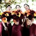 Bridesmaids bouquets of flame calla lilies and burgundy roses