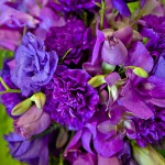 Cascading purple bridal bouquet with roses and carnations by Anne Mendenhall Flowers J Squared Events