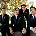 Groomsmen boutonnieres of flame calla lilies
