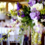 Tall centerpieces of roses and orchids