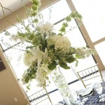 Tall centerpieces with white flowers by Anne Mendenhall Flowers