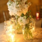 Mason Jar Centerpieces with white flowers and greenery