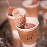 To Go coffee cups with custom sleeve cozy and cinnamon dessert on a stick