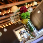 Centerpieces of Dahlia Babies Breath and Pin Cushion Protea in Glass Cylinder Vase