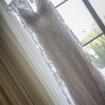 Lace Cap Sleeve Wedding Gown with Satin Sash and Open Back