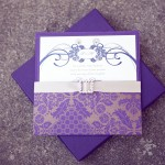 0001 purple and gold damask wedding invitation with gold satin ribbon and jewel buckle