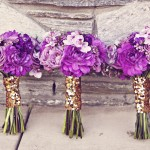 0005 hand tied purple bridesmaids bouquets with gold sequins ribbon by Floral Theory