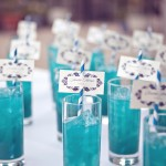 0034 hurricane blue specialty cocktail with striped straw and escort cards by j squared events planning and design