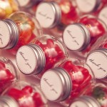 0064 candy wedding favors in mini glass jars with thank you stickers