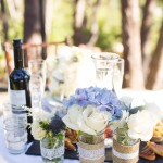 034 Blush and Ivory Roses with Blue Hydrangea Centerpieces in Mason Jars by Floravida and Gladys Jem Photography a J Squared Event