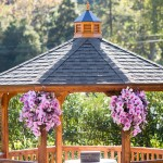 0149 ceremony gazebo florals of lillies by Gingerleaf Floral Elliston Vineyards same sex lesbian wedding by J Squared Events Lady of Light Photography
